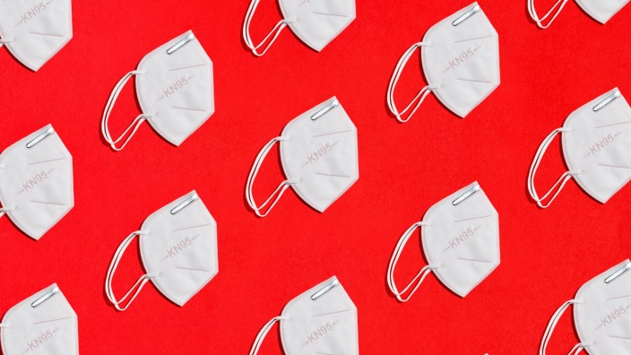 collage of some white masks for protection factor KN95 on red background zenith view Copyright: xCienxXxCienxStudiox