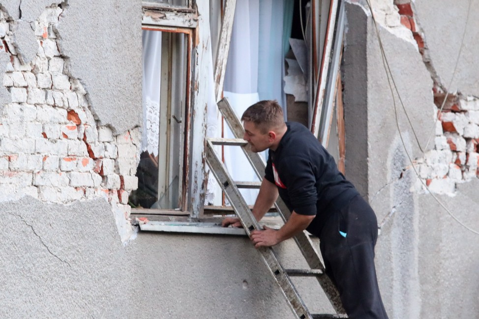 Aftermath after an earthquake in Petrinja, Croatia Man inspects a damaged building after an earthquake, in Petrinja, Cr
