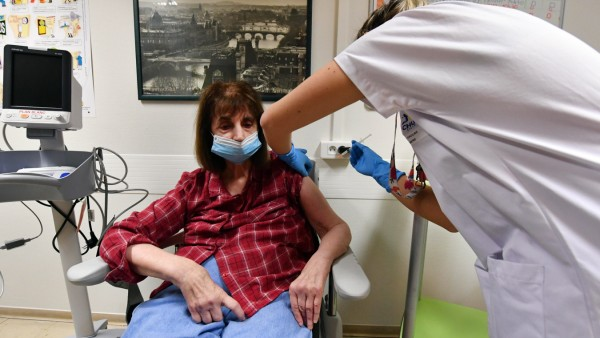 (201228) -- LILLE (FRANCE), Dec. 28, 2020 -- A woman receives a dose of COVID-19 vaccine in Lille, France, on Dec. 28,