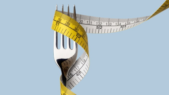 Fork with tape measure Fork with tape measure PUBLICATIONxINxGERxSUIxHUNxONLY SCIENCExPHOTOxLIBRARY
