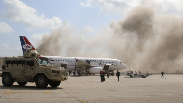 A military vehicle is seen on the tarmac during an attack on Aden airport moments after a plane landed carrying a newly formed cabinet for government-held parts of Yemen, in Aden