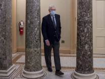 United States Senate Majority Leader Mitch McConnell (Republican of Kentucky) walks from his office to the Senate chamb