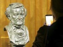 A visitor takes a picture of a bust of German composer Richard Wagner at the Richard Wagner Museum in Bayreuth