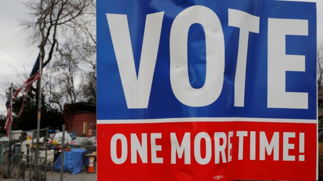 A sign urging residents to vote stands in Atlanta