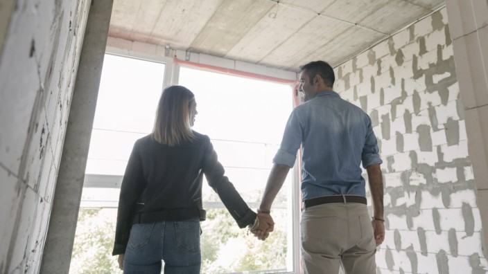 Happy couple of future owners at construction site model released Symbolfoto property released PUBLICATIONxINxGERxSUIxAU