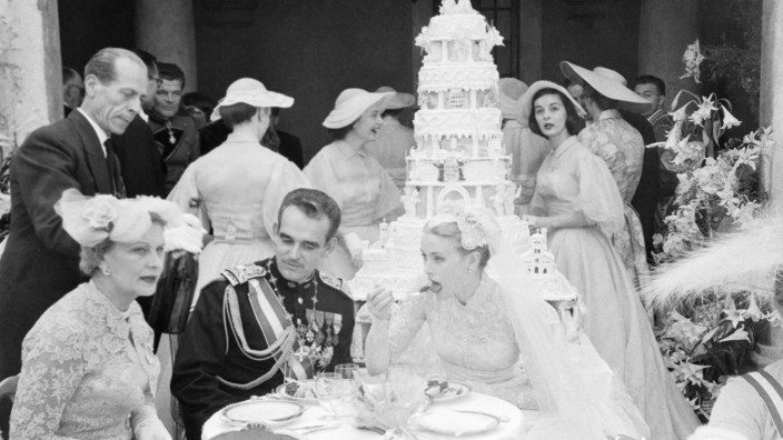 Prince Rainier and Grace Kelly Eating at Wedding Reception