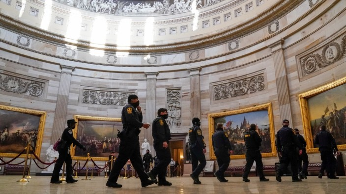 Business resumes a day after violence at the U.S. Capitol in Washington