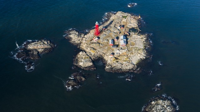 Aerial view of island with lighthouse