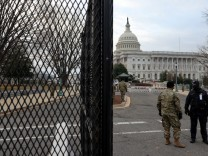 U.S. Capitol Police and National Guardsmen stand at an entrance to the Capitol in Washington