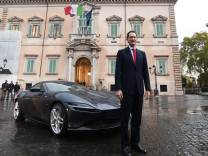 Fiat Chrysler chairman John Elkann poses next to the new Ferrari Roma outside the Quirinale Presidential Palace in Rome