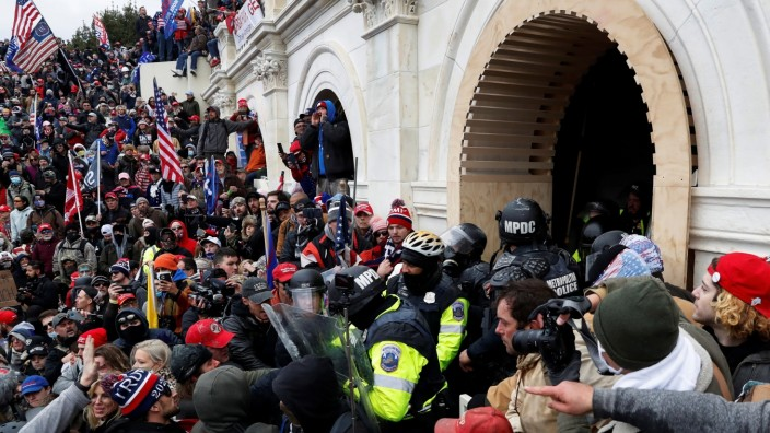 Pro-Trump protesters clash with police during a rally to contest the certification of the 2020 U.S. presidential election results by the U.S. Congress, at the U.S. Capitol Building in Washington