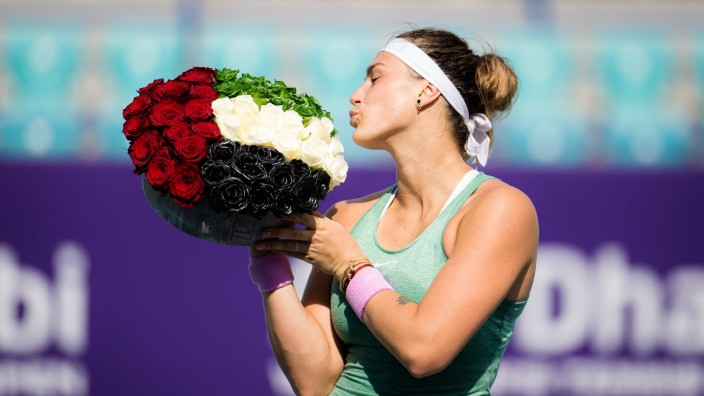 January 13, 2021, Abu Dhabi, UNITED ARAB EMIRATES: Aryna Sabalenka of Belarus poses with flowers after winning the fina