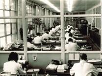 Employees in large office of Salamander Company 1960 nostalgic