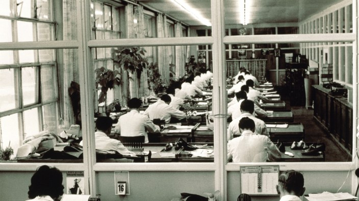 Employees in large office of Salamander Company 1960 nostalgic