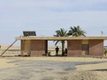 Egypt, western desert, railway station EGYPT, western desert, railway line Cairo to Bahariya Oasis, used for iron ore tr
