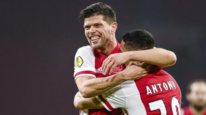AMSTERDAM - (lr) Klaas-Jan Huntelaar of Ajax, Antony or Ajax celebrate the 1-0 during the Dutch Eredivisie match betwee