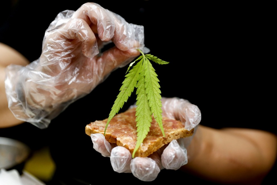 A chef prepares a pork sandwich with a marijuana leaf at Abhaibhubejhr hospital canteen which adds cannabis infused dishes to its menu in Thailand