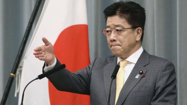 Japan s top government spokesman Kato Japanese Chief Cabinet Secretary Katsunobu Kato attends a press conference in Tok