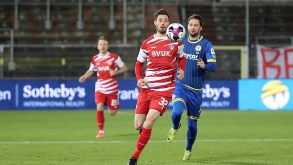 v.li.: Christian Strohdiek (FC Würzburger Kickers), Nick Proschwitz (Eintracht Braunschweig), 15.01.2021, Würzburg (Deut; Fußball - Zweite Bundesliga - Würzburger Kickers Christian Strohdiek