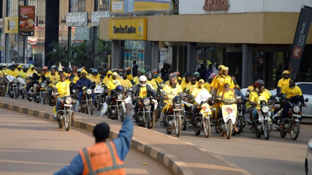 Supporters of Uganda's President Yoweri Museveni drive their motorcycles and celebrate the announcement of him winning the presidential elections, in Kampala