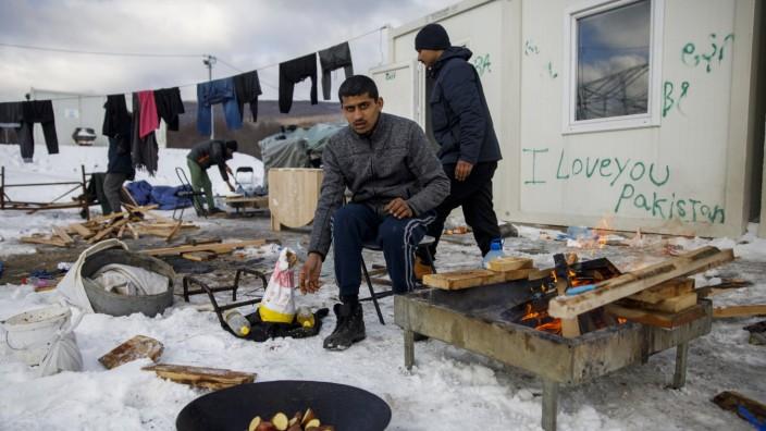 Hard winter in the Lipa migrant camp January 15, 2021, Bihac, Bosnia and Herzegovina - Migrants cook at the Lipa migran