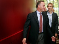 German national soccer team coach Klinsmann  Bayern Munich's Rummenigge and DFB President Mayer-Vorfelder leave a news conference at the soccer association head quarter in Frankfurt