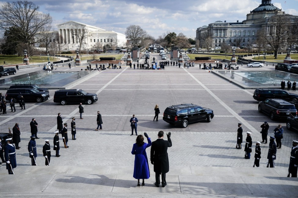 Vice President Kamala D. Harris and Doug Emhoff wave on the east steps to the U.S. Capitol after the inauguration of Pr