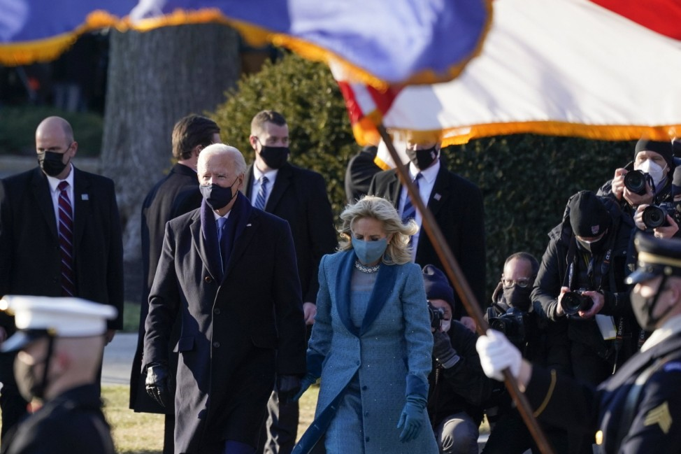 President Joe Biden and first lady Jill Biden walk toward the North Portico of the White House after the inauguration o