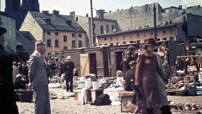 Hans Biebow, chief oft he German Nazi administration of theÊLodz ghetto at a street market.