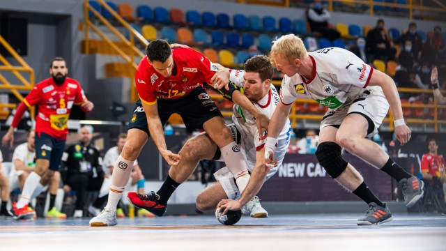 210121 Adrian Figueras Trejo of Spain competes for the ball with Johannes Golla and Sebastian Firnhaber of Germany duri