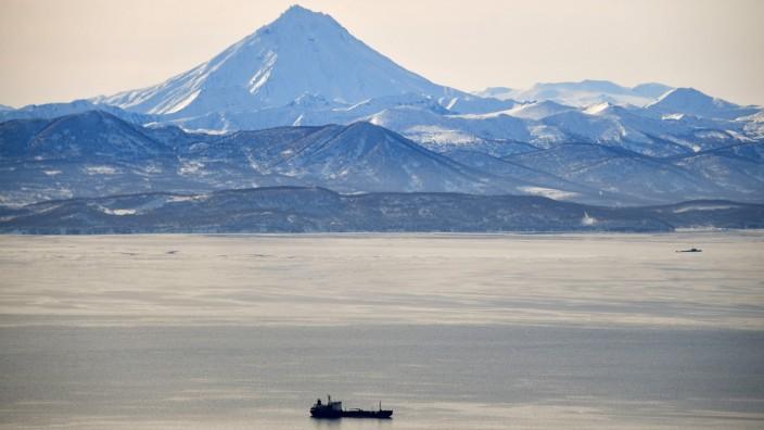 PETROPAVLOVSK-KAMCHATSKY, RUSSIA - FEBRUARY 21, 2020: A view of the Avacha Bay and Vilyuchinsky Volcano, 2,175m in heigh