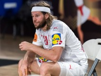 210127 Mikkel Hansen of Denmark looks dejected after receiving a red card during the 2021 IHF World Handball Championsh