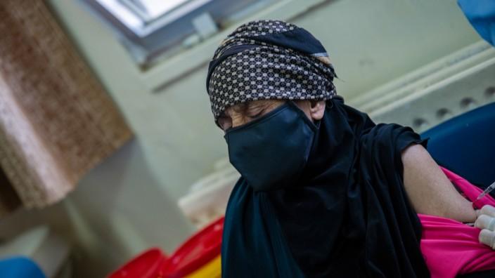 Jordan. 104 year old Aisha Khalil receives COVID-19 Vaccine
