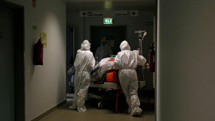 FILE PHOTO: A patient is carried to the COVID-19 Intensive Care Unit (ICU) of Cascais Hospital, amid the coronavirus disease (COVID-19) pandemic in Cascais