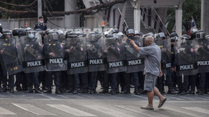 February 1, 2021, Bangkok, Thailand: A protester confronts the riot police during the demonstration..Thai riot police d
