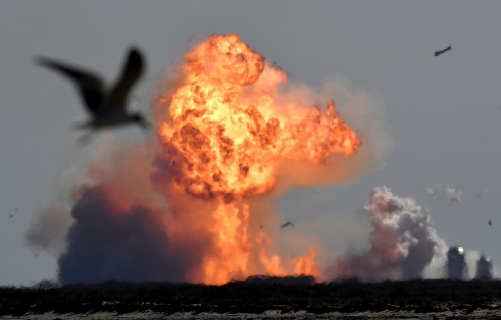 The SpaceX Starship SN9 explodes into a fireball after its high altitude test flight from test facilities in Boca Chica