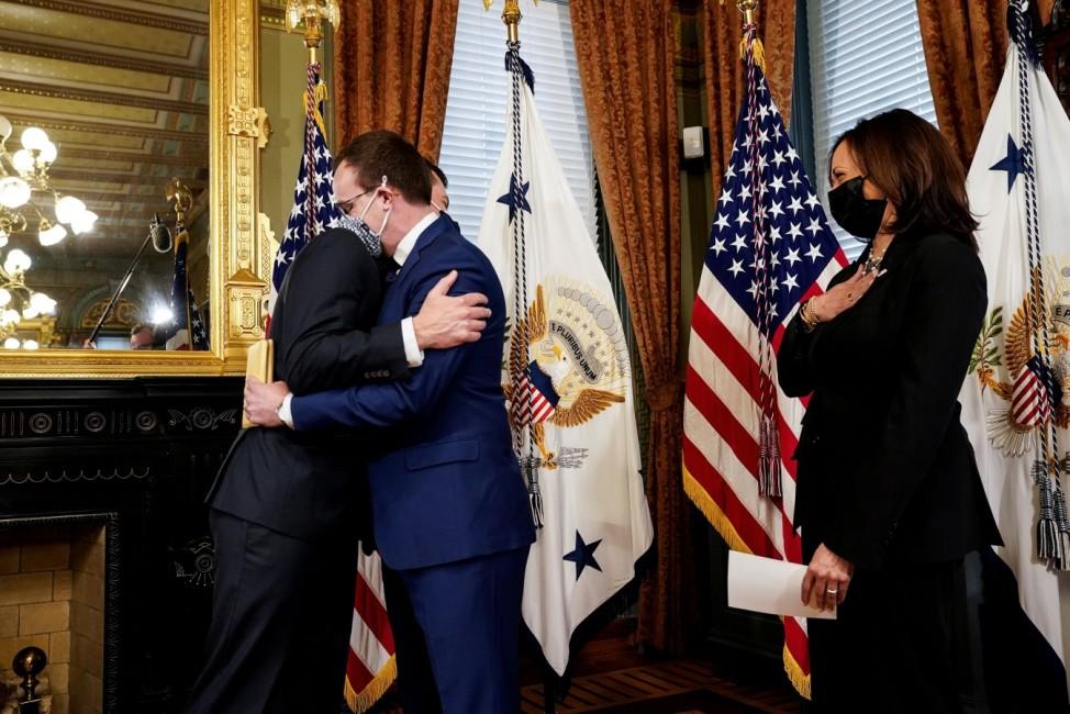 Newly confirmed Transportation Secretary Buttigieg is ceremonially sworn in by U.S. Vice President Kamala Harris at the White House in Washington