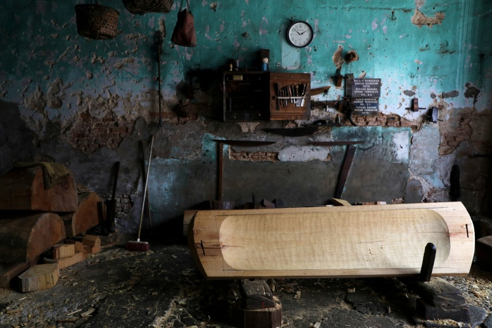 An unfinished coffin is pictured at a workshop, during a lockdown due to the coronavirus disease (COVID-19) outbreak, in Muar