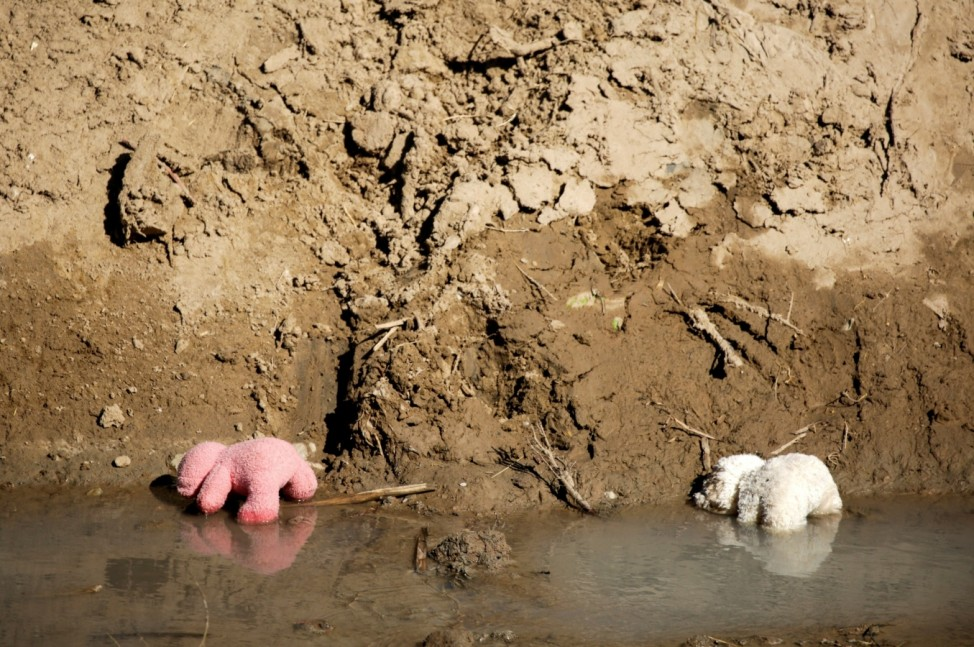 Teddy bears belonging to migrant girls are seen in the Rio Bravo river after they crossed into El Paso, Texas, U.S., to turn themselves in to request asylum, as seen from Ciudad Juarez