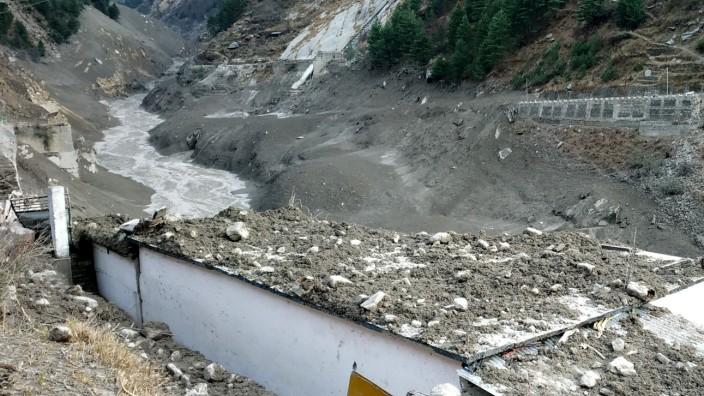 A view shows damage after a Himalayan glacier broke and crashed into a dam at Raini Chak Lata