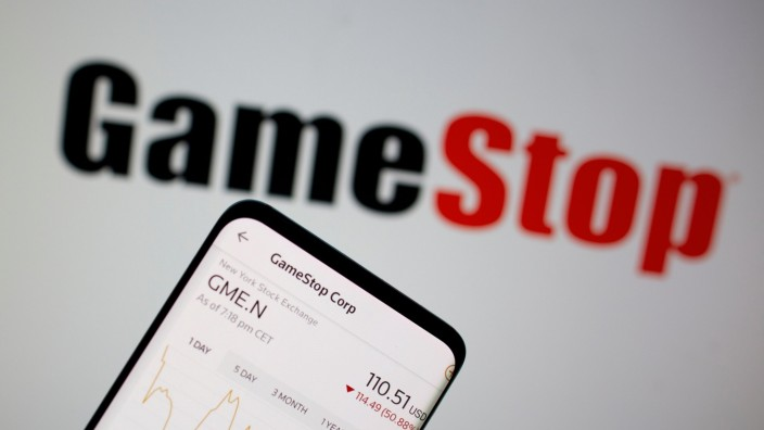 FILE PHOTO: GameStop stock graph is seen in front of the company's logo