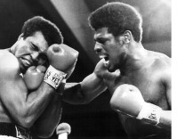 LAS VEGAS ---- HEAVYWEIGHT CHAMPION MUHAMMAD ALI (LEFT) GRIMACES AS CHALLENGER LEON SPINKS GETS IN A STINGING RIGHT CRO