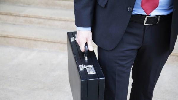 Mann mit Geldkoffer Mann mit Geldkoffer