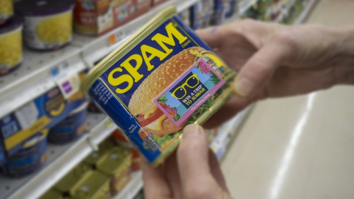 In advance of Hormel Foods first quarter A shopper chooses a can of Spam by Hormel Foods in a superm