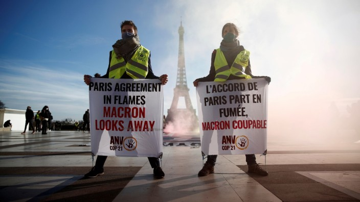 FILE PHOTO: Climate activists mark the fifth anniversary of the Paris Agreement on climate change, in Paris