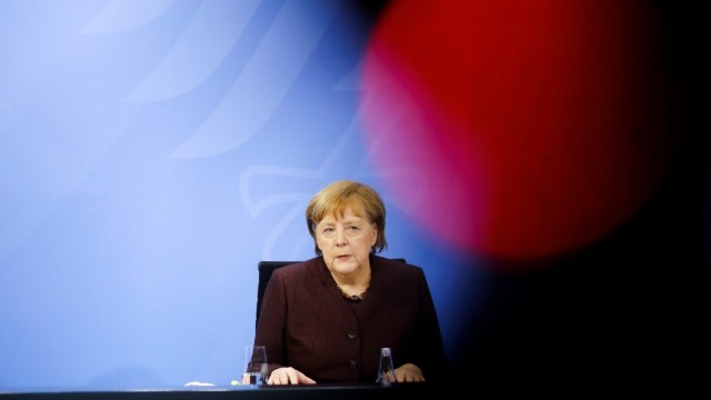 German Chancellor Angela Merkel briefs the media during a news conference in Berlin