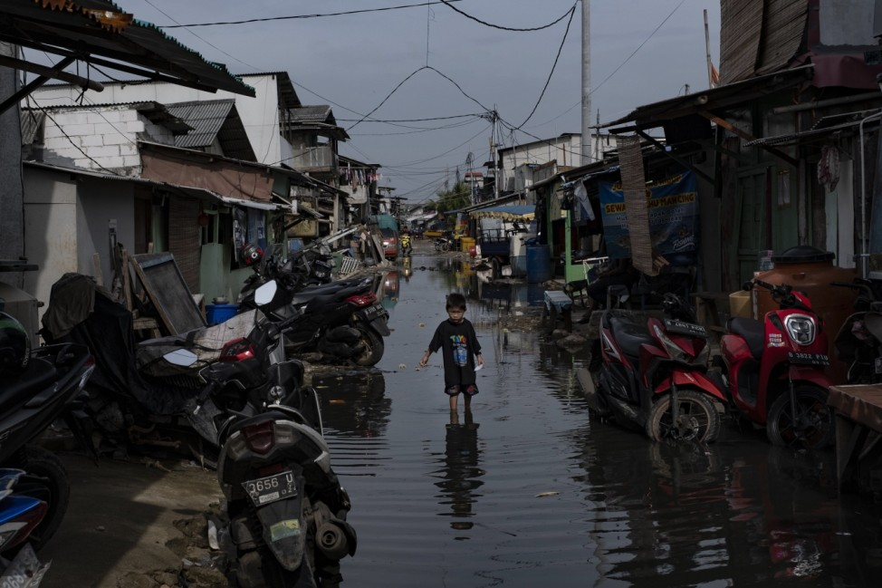 High Tide Submerges Parts Of Jakarta's Sinking Coastline