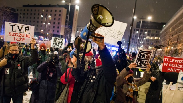 February 10, 2021, Warsaw, Poland: A protester shouts slogans on a megaphone towards the Polish Information tv s headqua