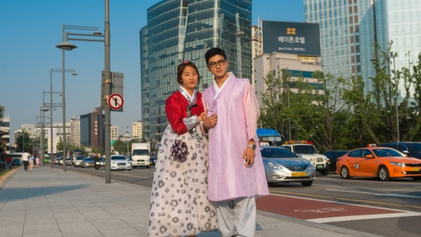 SOUTH KOREA - COUPLE IN TRADITIONAL KOREAN CLOTHING IN THE STREET - SEOUL Couple in traditional korean clothing in the s