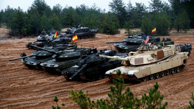 U.S., German, Spanish and Polish troops of the NATO enhanced Forward Presence battle goups with their tanks get ready for the Iron Tomahawk exercise in Adazi,
